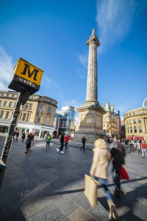 image of Grey's Monument with the Metro sign