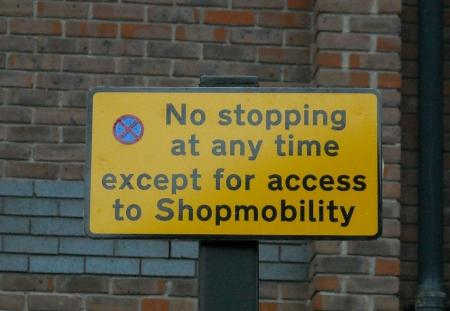 Sign adjacent to bay on Handyside place states 'No stopping at any time except for access to Shopmobility'