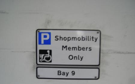 Shopmobility sign in bays state 'Shopmobility members only'