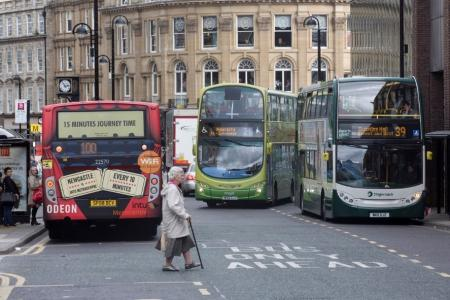 view of busy buses on baclkett Street