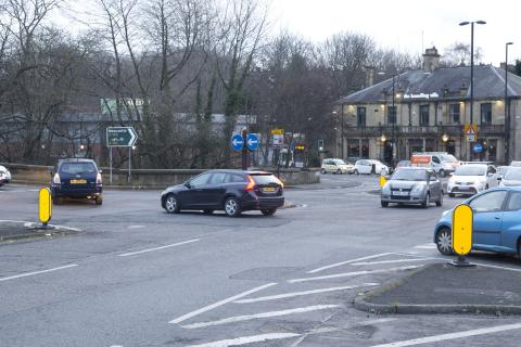 Photo showing cars at Haddricks Mill junction.