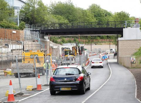 Photo showing cars driving past roadworks on Killingworth Road