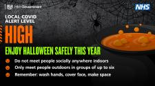 Halloween graphic with information asking people to enjoy Halloween safely this year and reminding people that the local Covid alert level is high.