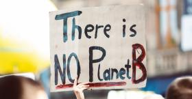 Protest sign with There is no Planet B written on it