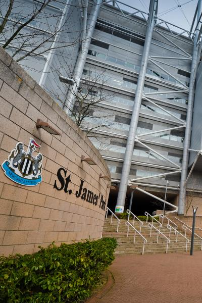 Some steps leading into St James' Park beside the NUFC club crest