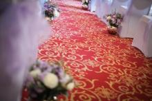 A wedding isle decorted with fragrant flowers